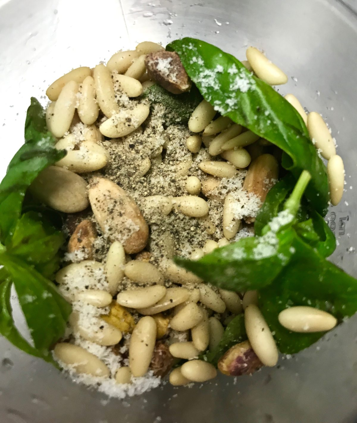 Making pesto with almonds, pine nuts and basil leaves annasfoodstories