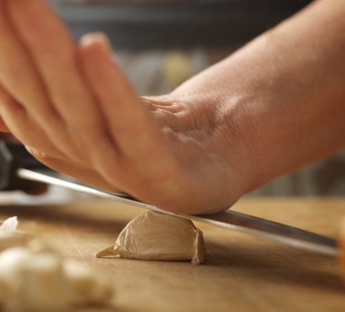 garlic knife and hand annasfoodstories